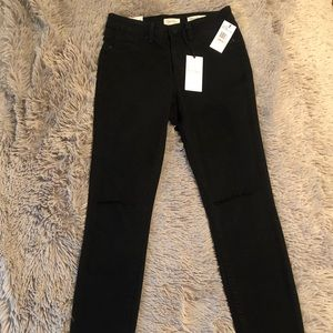 Jessica Simpson black skinny jeans with rips